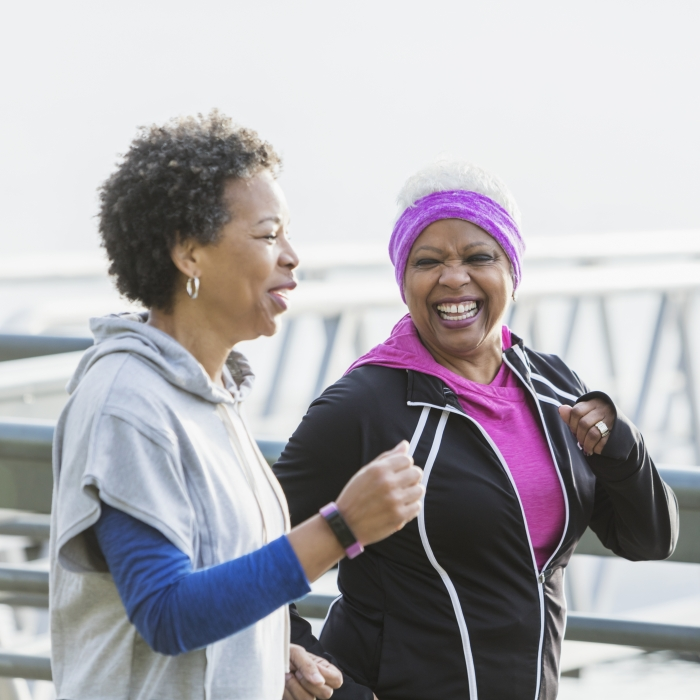 Two mature women jogging or power walking together