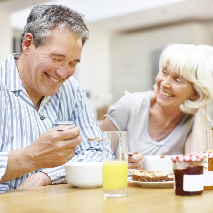 Mature couple eating breakfast